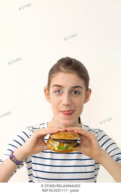 Girl holding hamburger