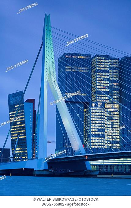 Netherlands, Rotterdam, Erasmusbrug bridge and new commerical towers at the renovated docklands, dawn
