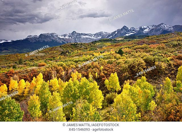 Snow clouds threaten the beautiful autumn colors carpeting the Rocky Mountains