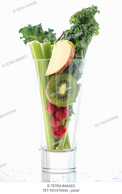 Studio shot of fruits and vegetables in glass