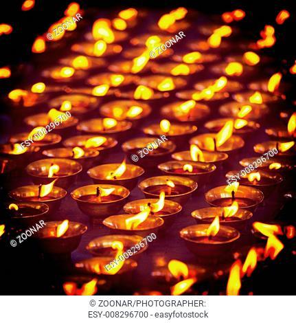 Burning candles in Buddhist temple, McLeod Ganj