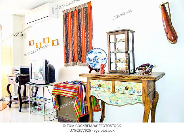 Apartment living-room interior with modern and antique furniture in downtown Cebu City, Philippines