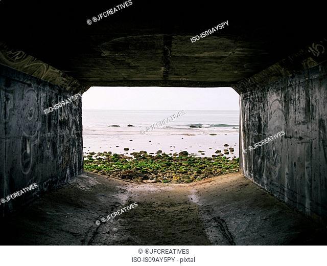 Rectangular tunnel looking out to sea, La Conchita, California, USA