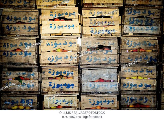 Pile of fruit wooden boxes with arabic hand writing. The Nouvelle Ville Market, Fes, Morocco, Africa