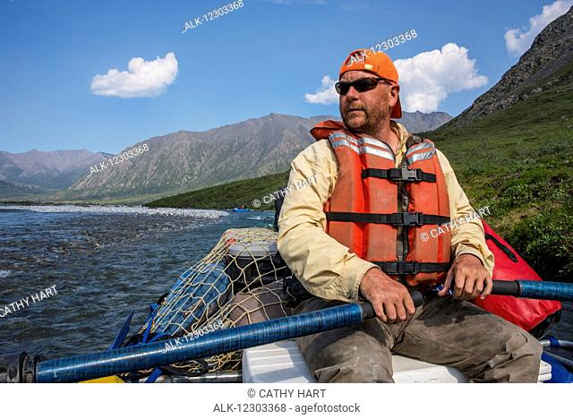 Rafter on the Marsh Fork of the Canning River, ANWR, Arctic Alaska, summer