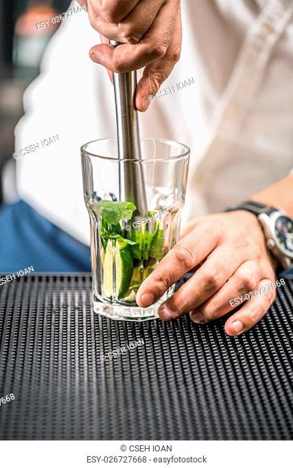 Bartender preparing mojito cocktail drink
