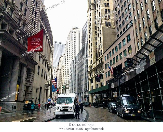 New York, USA. Small street with facades and skyscrapers Down Town Manhattan