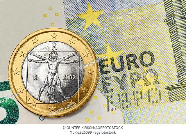 a 1 euro coin from Italy on a 5 euro banknote