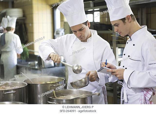 Chef pouring stock into a pan