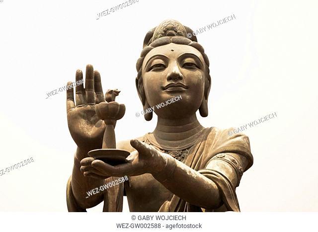 China, Hongkong, Lantau Island, Ngong Ping, Buddhistic statue praising, making offerings to Tian Tan Buddha