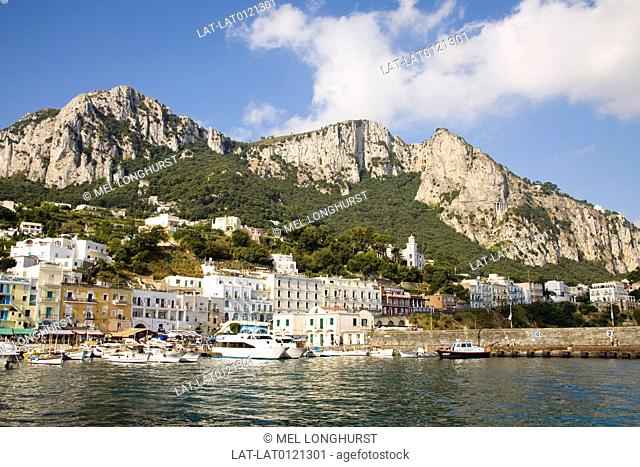 View of harbour,buildings and mountains from the sea,Marina Grande,Capri,Italy