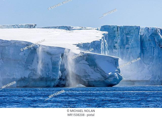 Katabatic winds blow snow into the sea off glacier face at Brown Bluff, Weddell Sea, Antarctica, Polar Regions