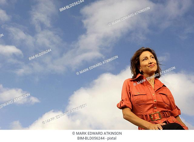 Hispanic woman under blue sky