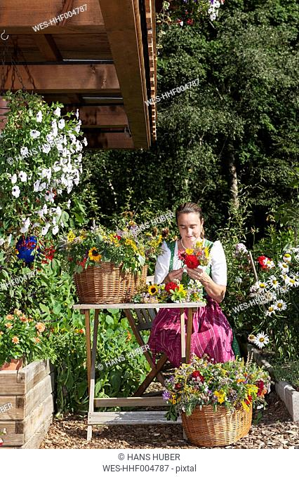 Austria, Altenmarkt, Farmer's woman binding bouquets