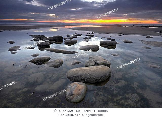 Rocks in a tidal pool at sunset at Dunraven Bay near Southerdown