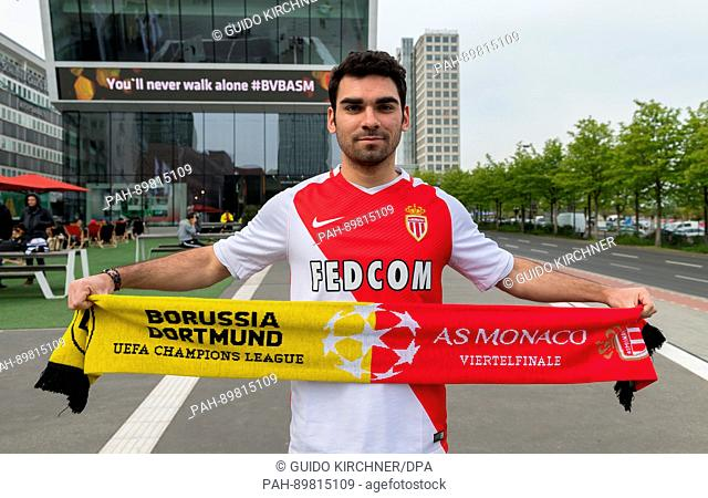 AS Monaco fan Loic from Lyon stands in front of the German soccer museum in Dortmund, Germany, 12 April 2017. 'You'll never walk alone #BVBASM' can be seen on a...