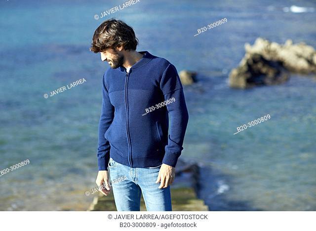 Adult man at the coast of Santa Clara Island, Donostia, San Sebastian, Gipuzkoa, Basque Country, Spain, Europe