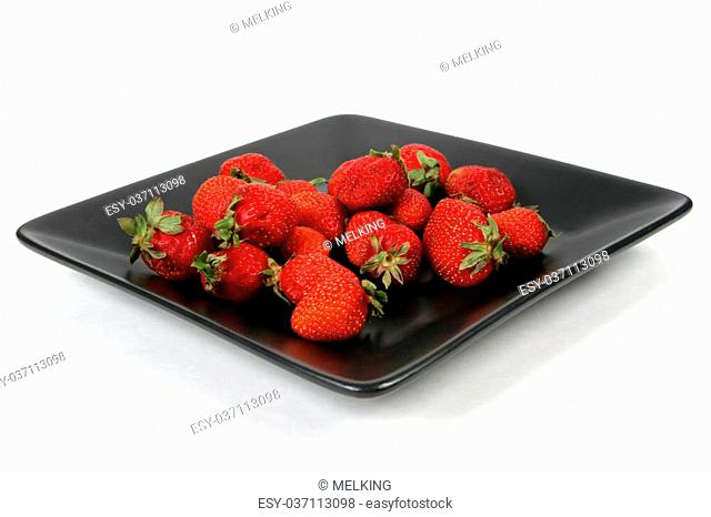 strawberries on Black Plate over White