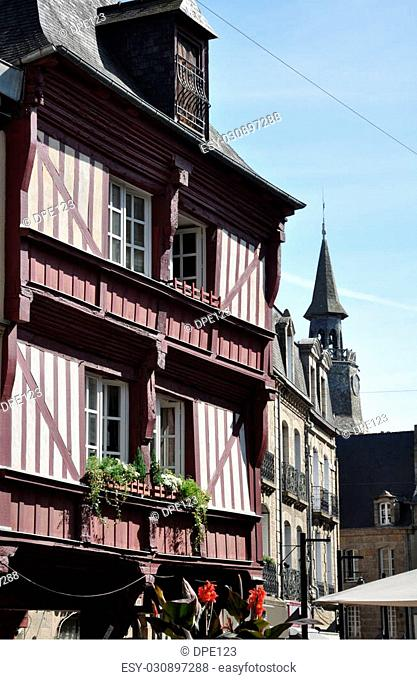 Medieval buildings in the ancient french town of Dinan in Brittany. These old houses are in the centre of the town and the, tour de l'horoge, clock tower