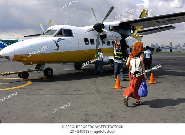Manila Airport. Flyseair company. The Visayas. Philippines Luzon Palawan Province Puerto Princesa Flyseair Low Cost Airline Flight Coral Island in Shape of a...