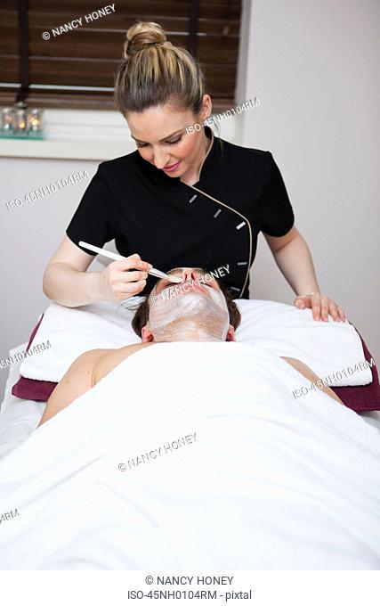 Man having facial in spa