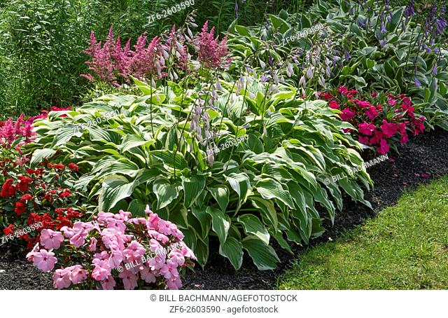 Bar Harbor Maine colorful flower garfdens and arch in yard of home in summer