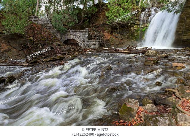 Running stream and waterfall in Autumn at Hilton Falls; Campbellville, Ontario, Canada