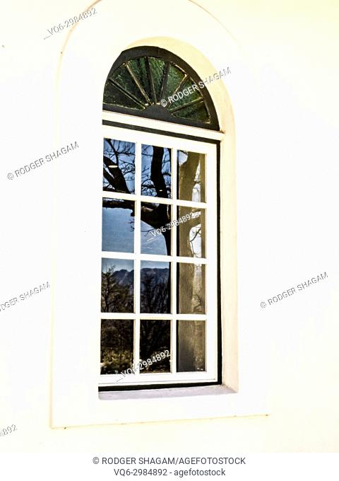 Closed window with an arch above. Cape Town, South Africa