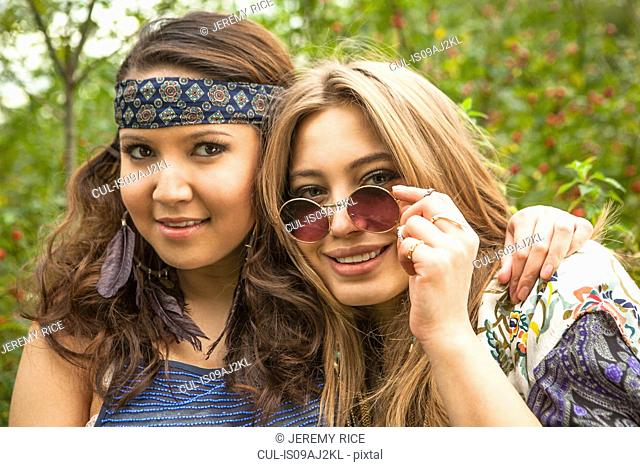 Two hippy girls looking at camera