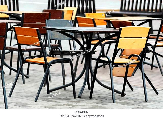 Empty coffee terrace with tables and chairs, outdoors