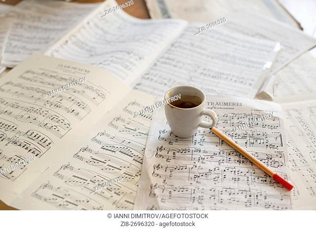 Strong coffee and music score on musicians desk