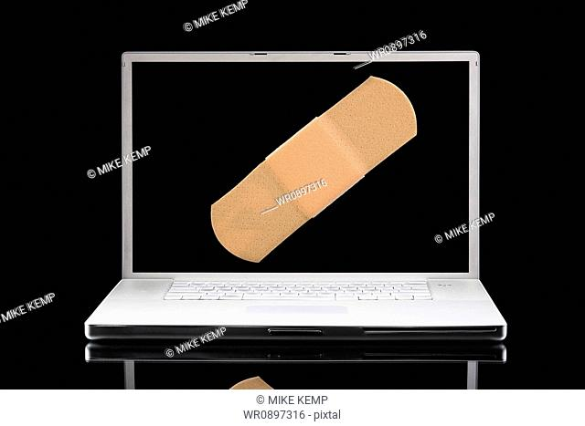 Laptop computer with a Band-aid on the screen