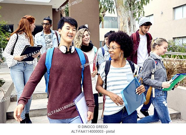 College students walking and chatting together on campus