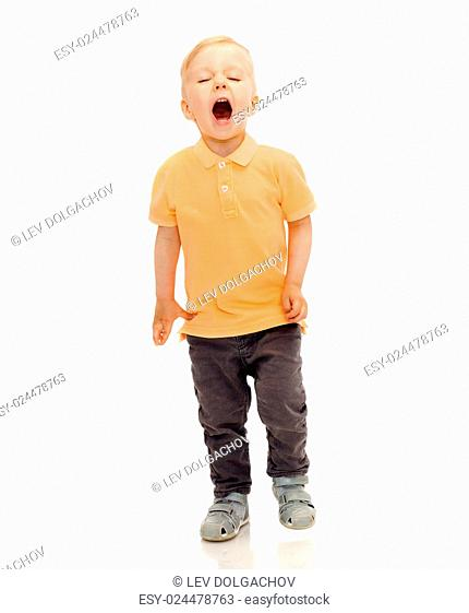 childhood, emotion, expression, fashion and people concept - happy little boy in casual clothes shouting, crying or sneezing