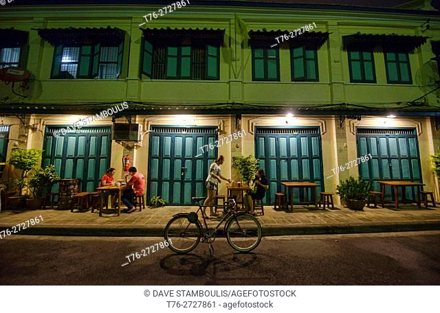 Traditonal row shophouses in the atmospheric Phraeng Phuton Square in Bangkok, Thailand