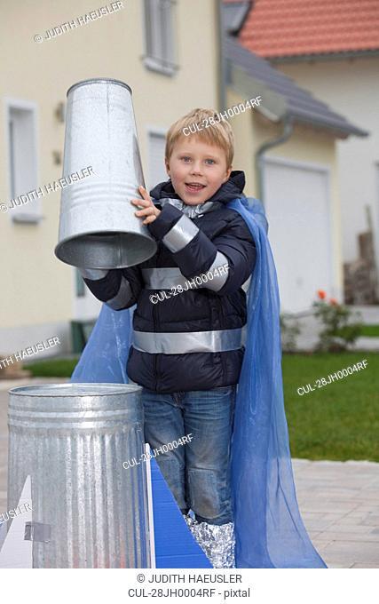 Boy constructing rocket