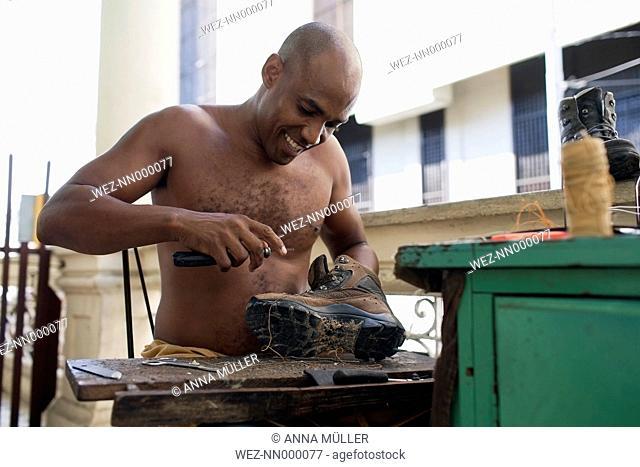 Cuba, Santiago de Cuba, cobbler at work