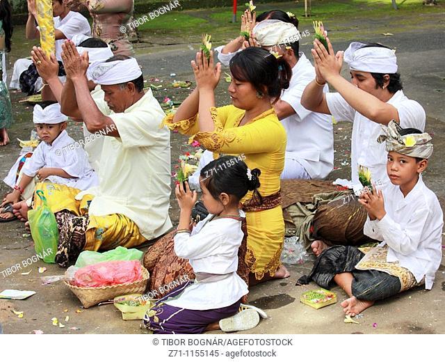 Indonesia, Bali, Mas, temple festival, people praying, odalan, Kuningan holiday