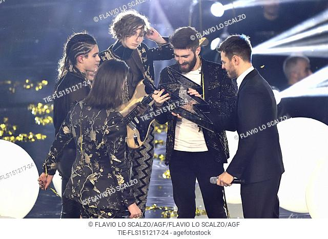 The winner of X Factor 2017 Lorenzo Licitra ( in the center ) with the Maneskin and Alessandro Cattelan at the talent show X Factor 2017, Milan