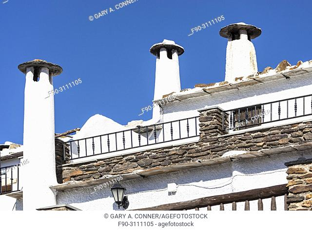 Typical high chimneys at small mountain village of Capileira Spain