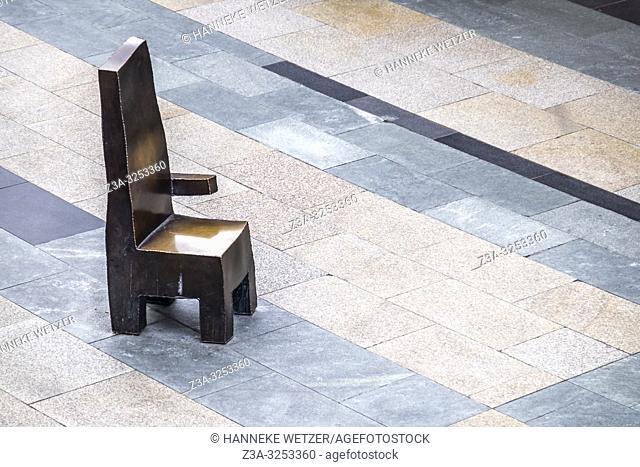 Bronze chairs designed by Maarten Baas for men waiting for their shopping wife to get back, Rotterdam, The Netherlands, Europe