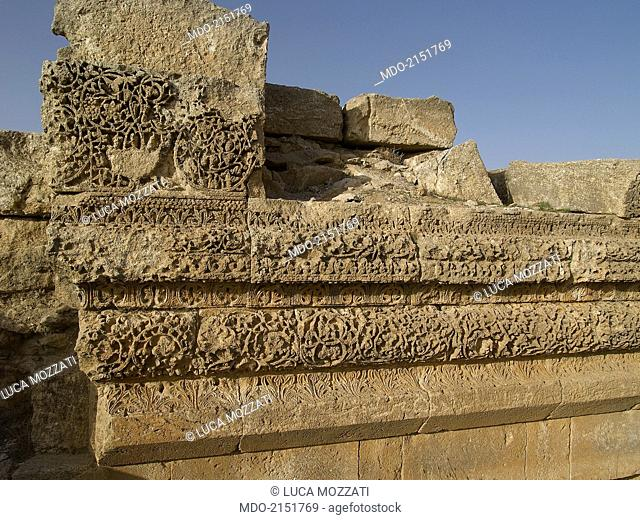 Umayyad Palace of Mshatta, 743, 8th Century A.D., stone building. Jordan, Amman. Detail. Outer wall with remains of a refined decoration in a plant motif; the...