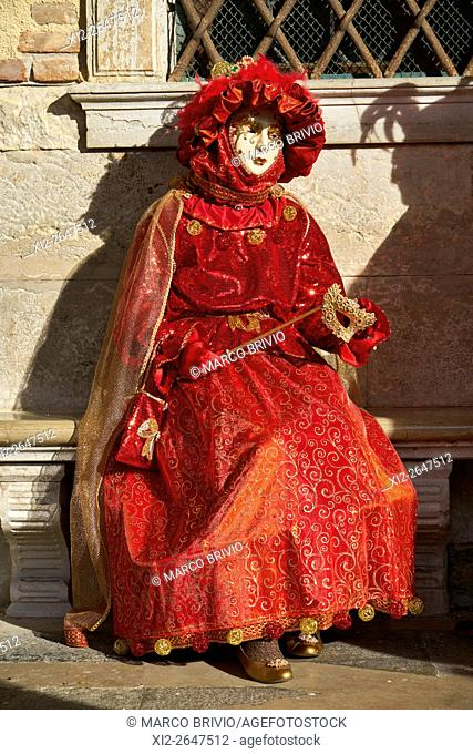 Colourful artistic masks at the Venice Carnival. Italy by St. Mark's Square