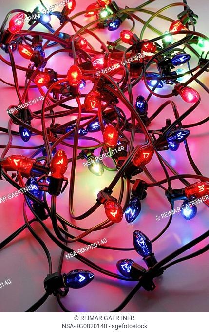 Jumble of red and blue Christmas lights