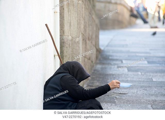 Beggar begging in the street, Santiago de Compostela, A Coruña, Galicia, Spain, Europe