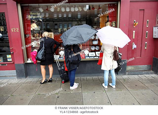 Women in front of shop window. Amsterdam, The Netherlands