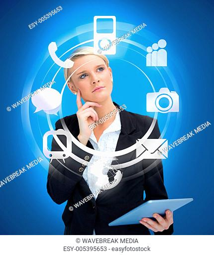 Businesswoman with tablet pc considering various applications