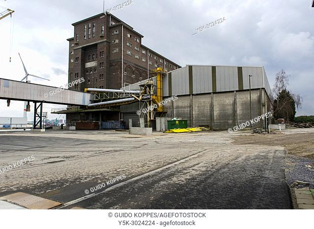 Antwerp, Belgium. Decomissioned and old fashioned grane silo on America Docks of Antwerp Harbour. The entire industrial zone is subject to gentrification