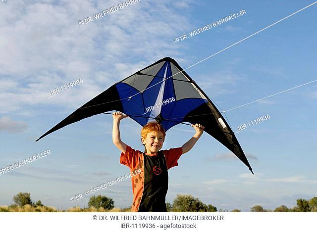 Boy flying kite, kite flying, kiting