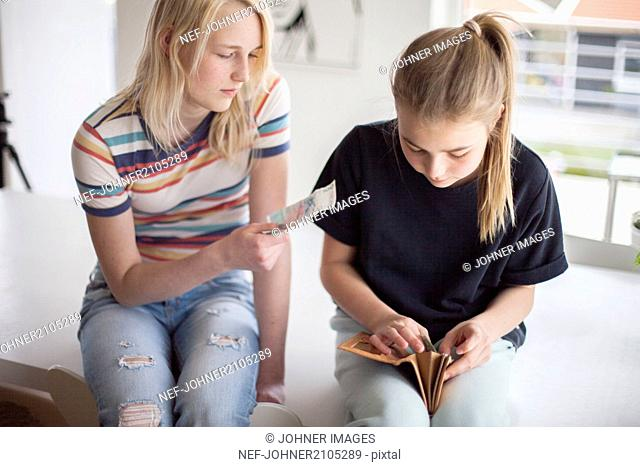 Girls counting money